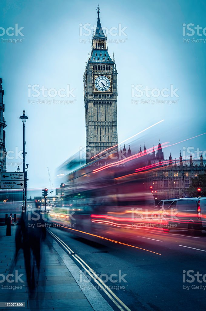 Big Ben at dusk with passing Double Decker buses (II) royalty-free stock photo