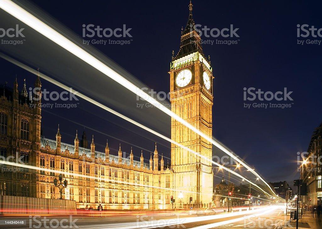 Big Ben at night against blue sky. London traffic royalty-free stock photo