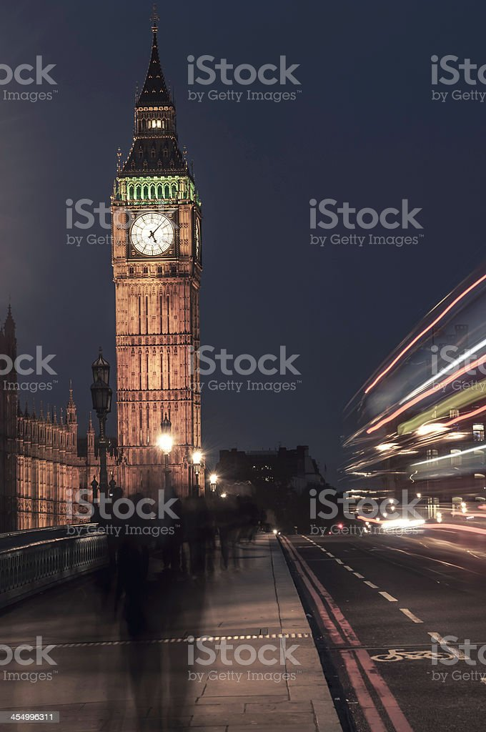 Big Ben at night with passing pedestrians - IV royalty-free stock photo
