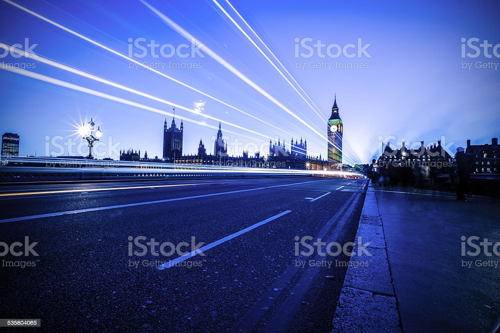 Big Ben Clock Tower in London light trails at twilight stock photo