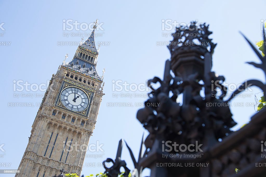 Big ben in background with security fence in foreground stock photo