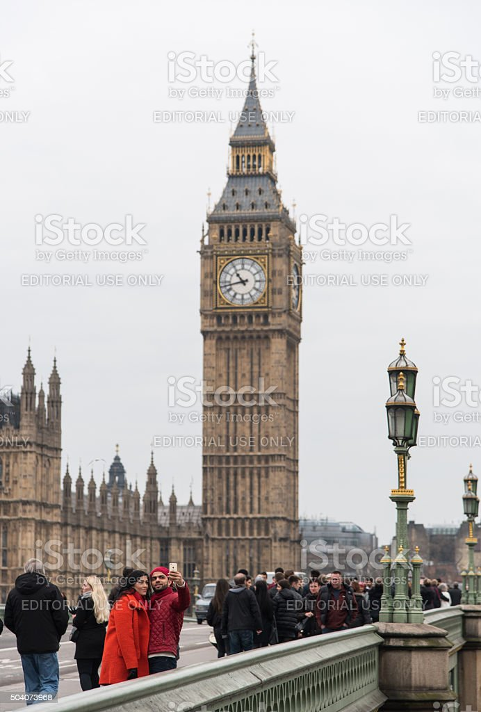 Big Ben London and people walking on the Westminster Bridge stock photo