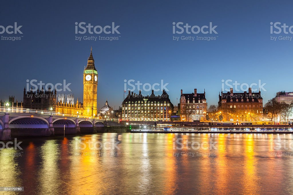 Big Ben over the Westminster Bridge at night stock photo