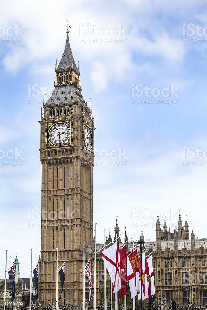 Big Ben Tower Rises Tall above Flags royalty-free stock photo