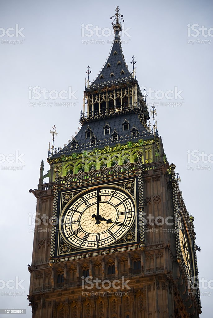 Big Ben, Westminster (London), at 4 pm - illuminated, close-up royalty-free stock photo