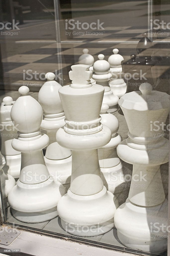 Big black and white figures for chess game stock photo
