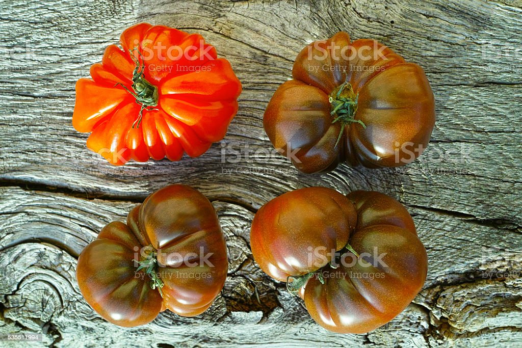 Big Black Heirloom and Oxheart tomatoes stock photo