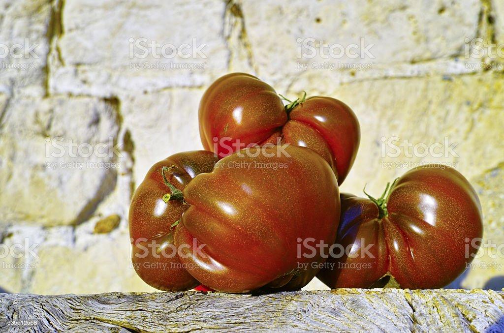 Big Black Heirloom tomatoes stock photo