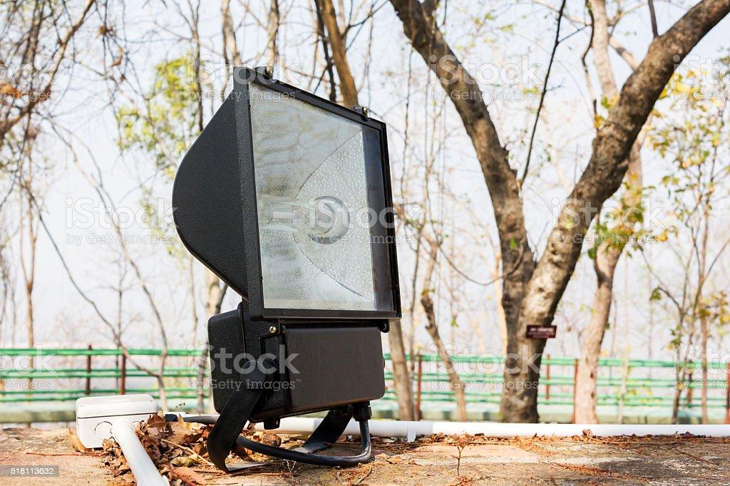 Big black spotlight or footlight set up at outdoor park stock photo