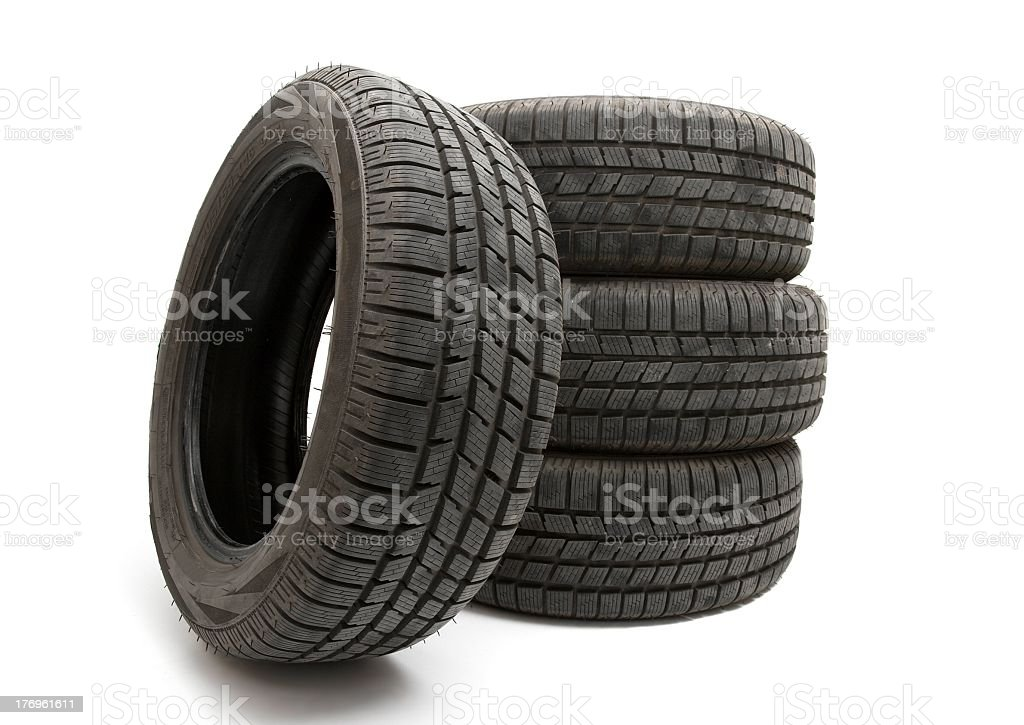 4 big black tires isolated on white stock photo