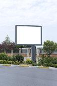 Big blank horizontal billboard on the city street.