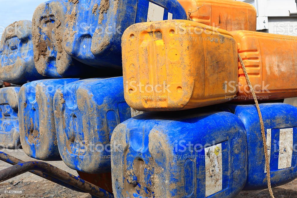Big blue and yellow plastic jerrycans. Afrera-Ethiopia. 0170 stock photo
