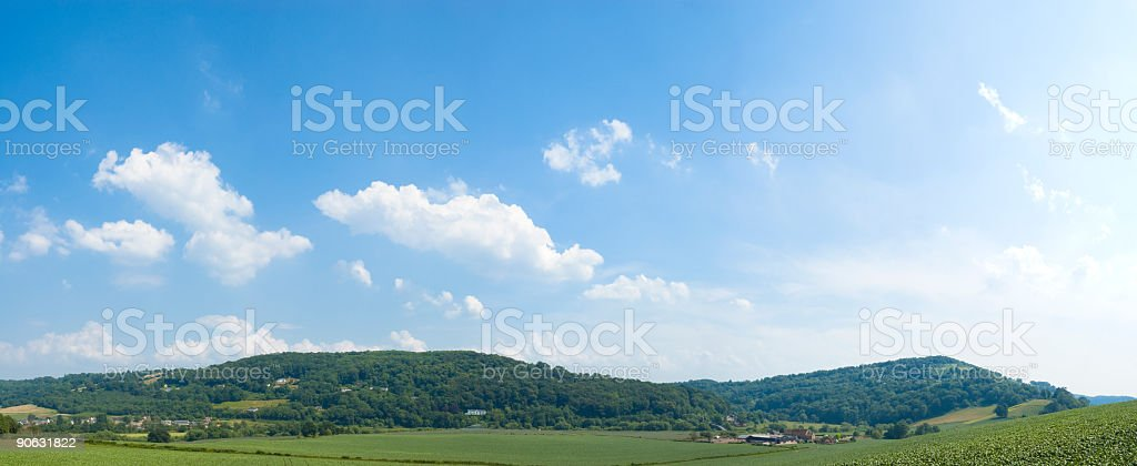 Big blue sky, rolling green landscape royalty-free stock photo