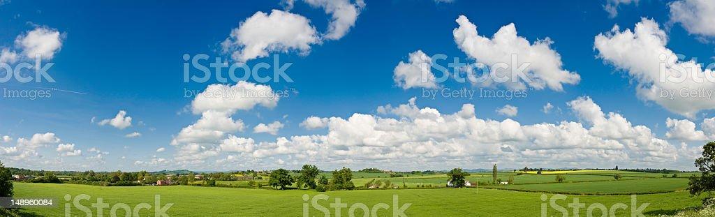 Big blue summer skies green farms royalty-free stock photo