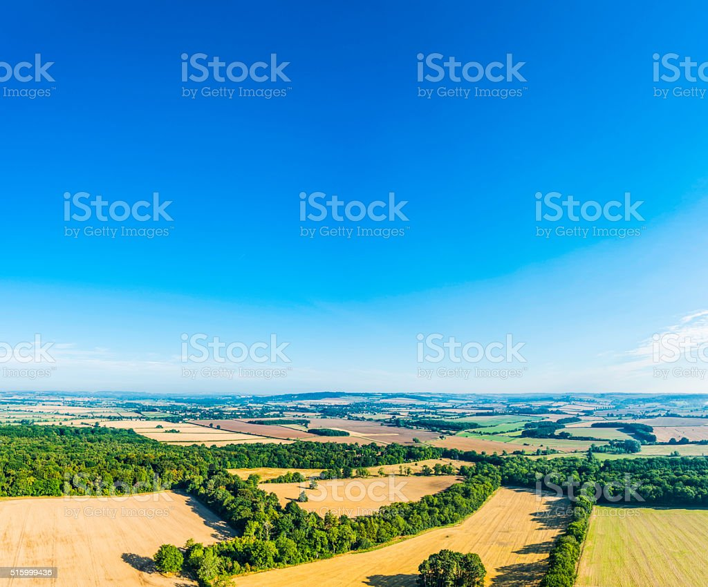 Big blue summer skies over farms fields countryside aerial photograph stock photo