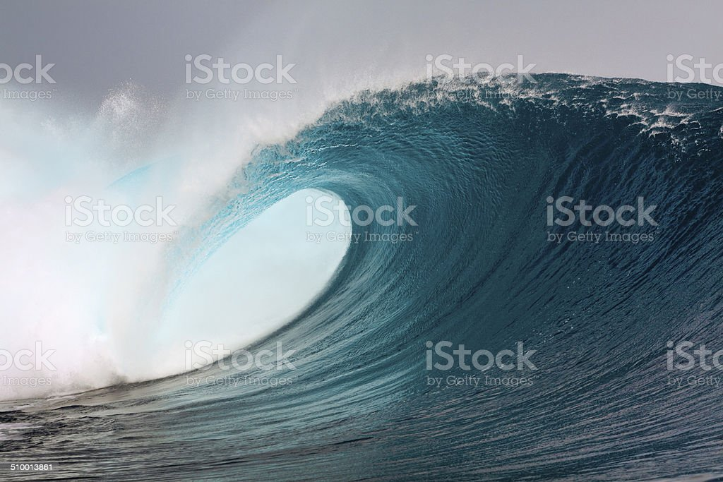 Big blue surfing wave stock photo