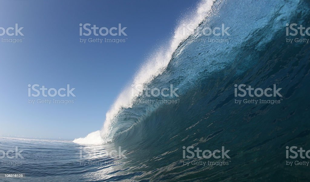 big blue wave crashes down stock photo