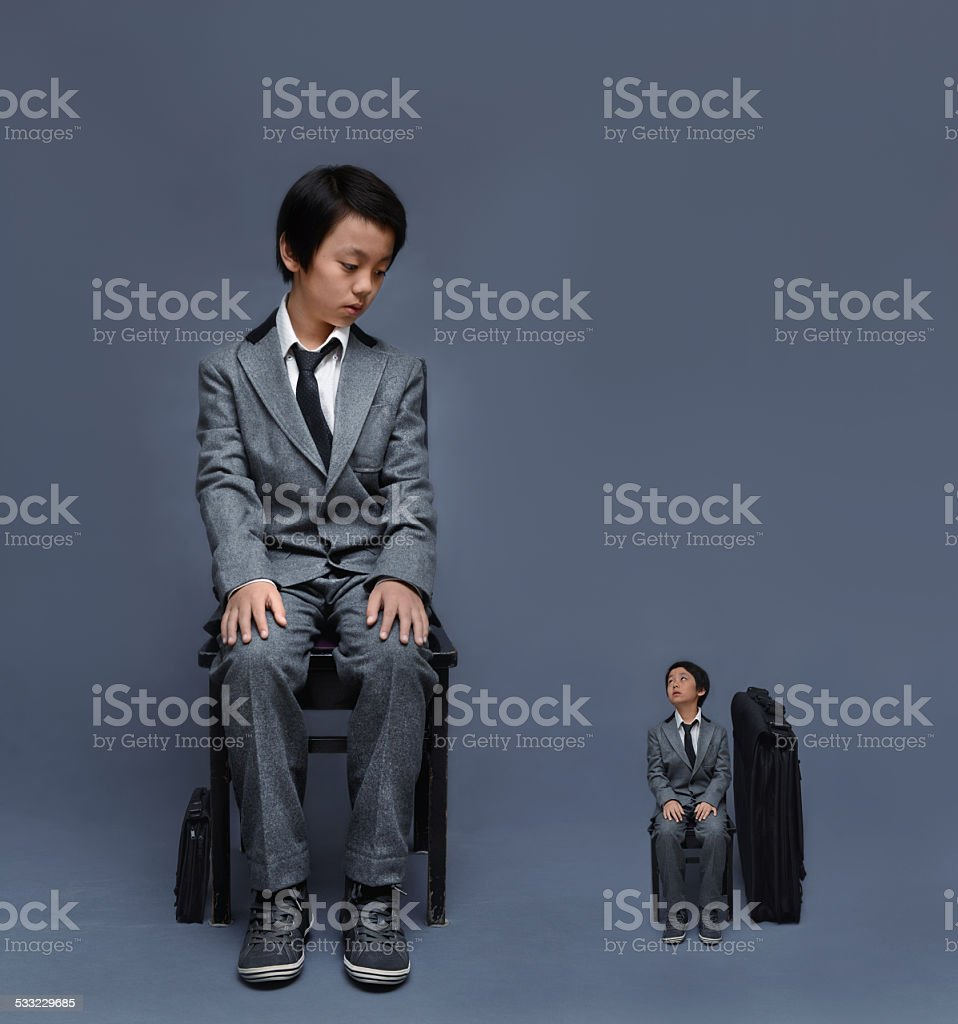 Big boy, small boy (in suit) stock photo
