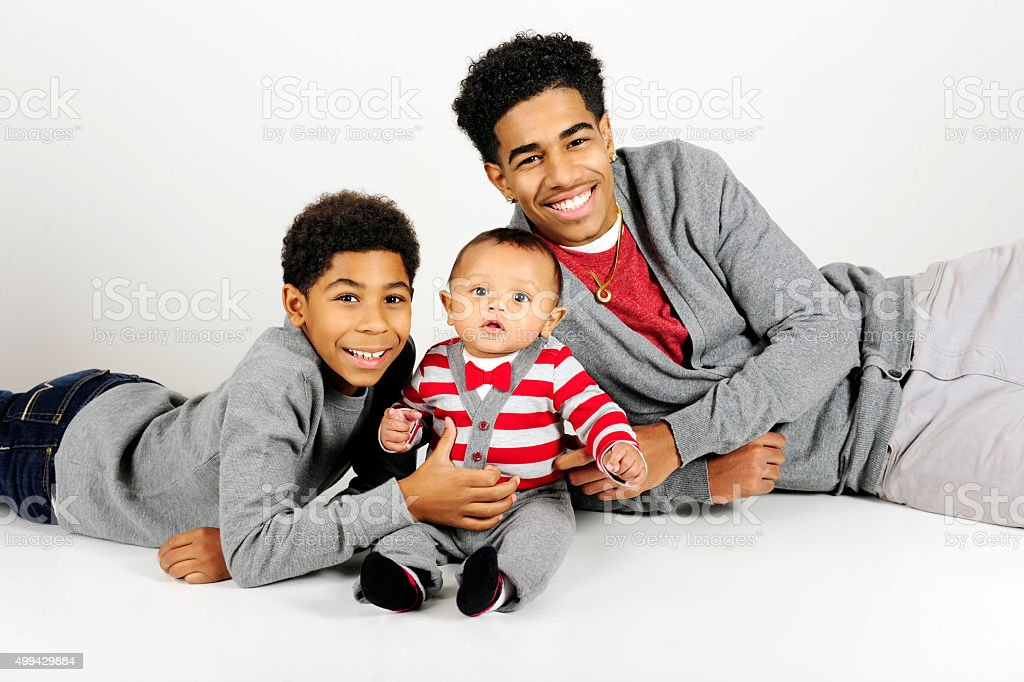 Big Boys Happy with Baby Brother stock photo