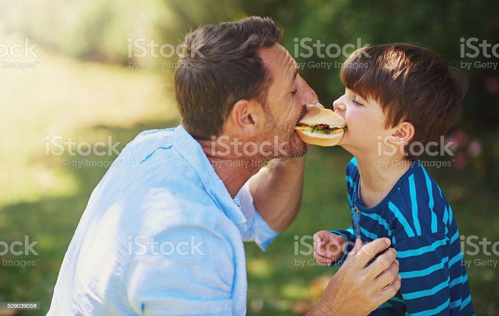 Big boys take big bites stock photo