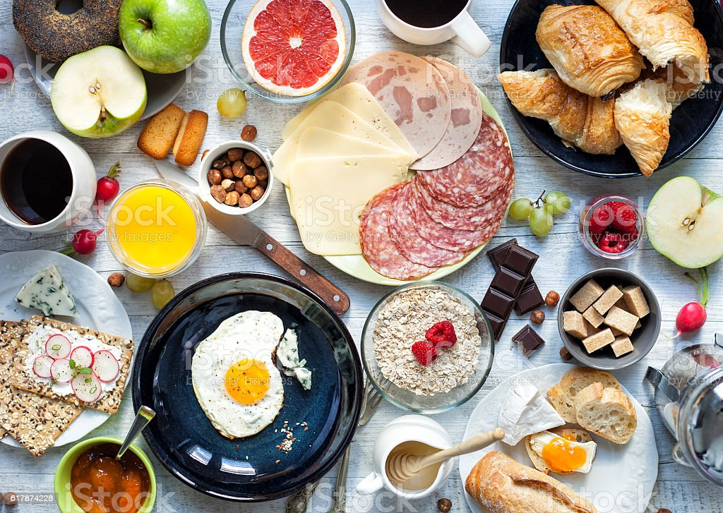 Big breakfast on the white rustic table. stock photo