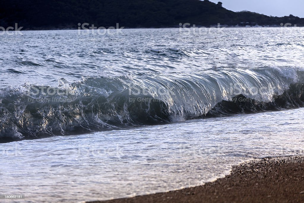 Big breaking wave on the beach royalty-free stock photo