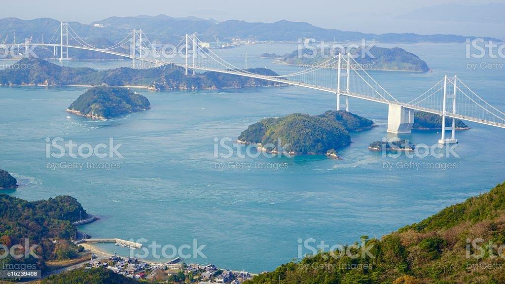 Big bridge which spans a strait in Kurushima stock photo
