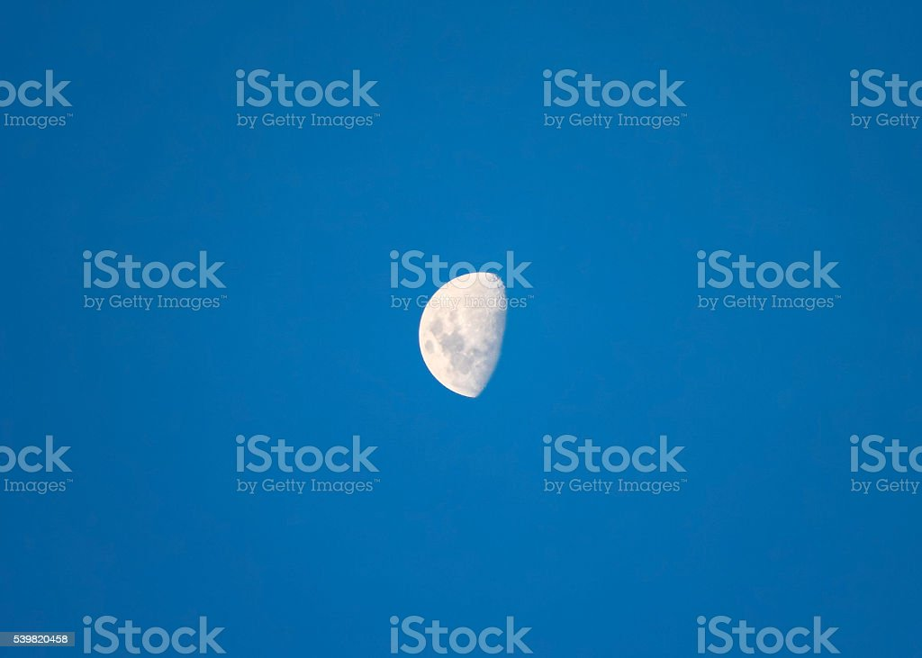 Big bright moon waxing gibbous stock photo