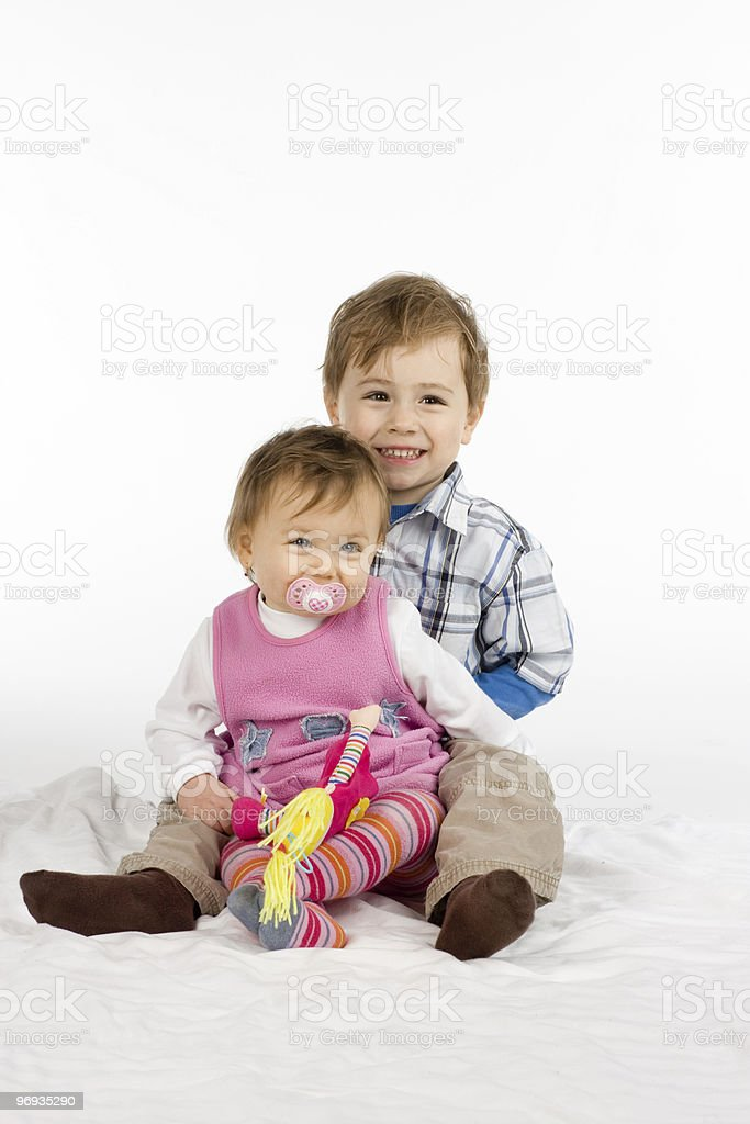 Big brother and baby sister stock photo