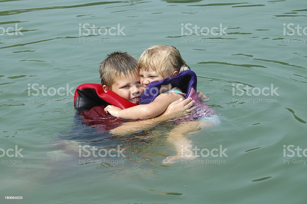 Big Brother and Little Sister in the lake stock photo