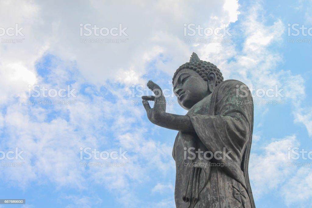 Big Buddha statue ancient on blue sky background stock photo