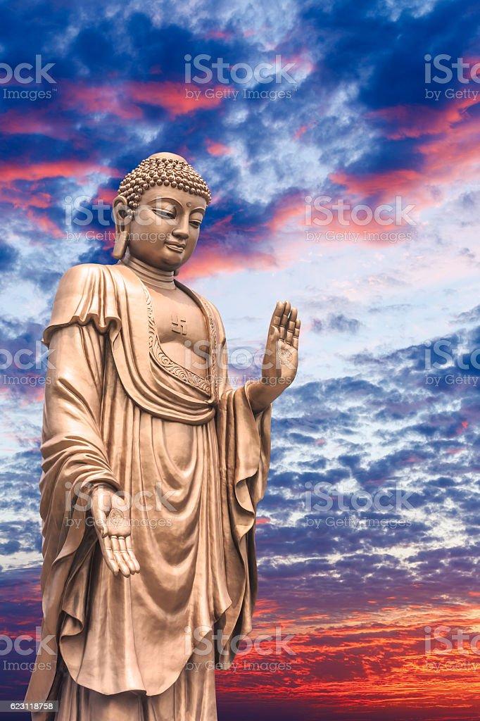 Big Buddha statue on sunset sky stock photo
