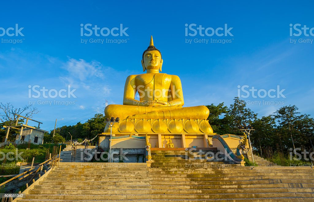 Big Buddha Statue sunset blue sky in laos stock photo