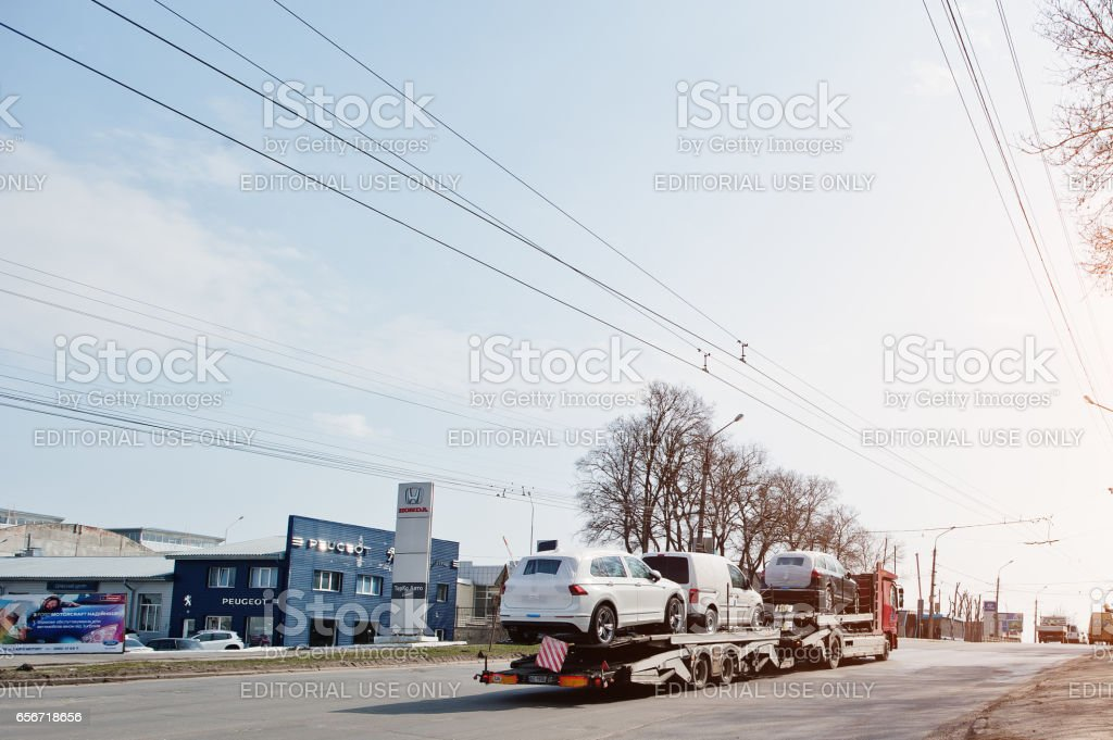 Kiev, Ukraine - March 22, 2017: Big car carrier truck of new Volkswagen cars for batch delivery to dealership. stock photo