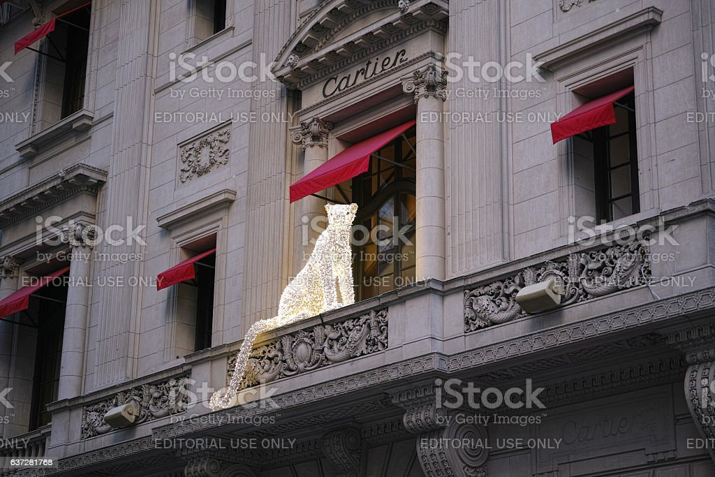 Big cat sculpture made out of christmas decoration lights stock photo
