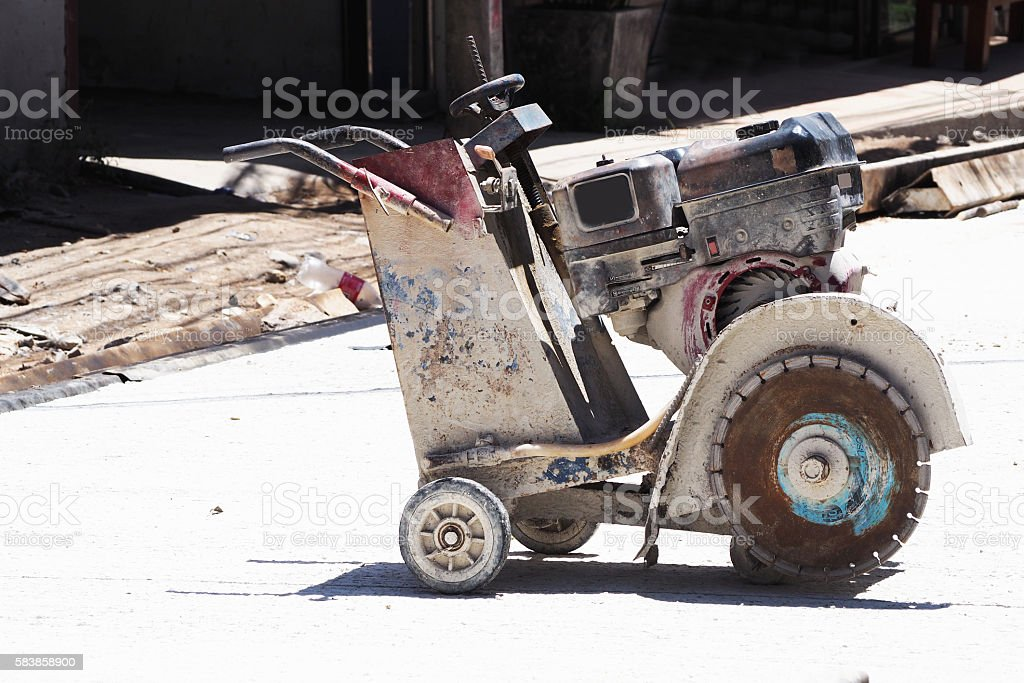big cement cutting machine for road stock photo