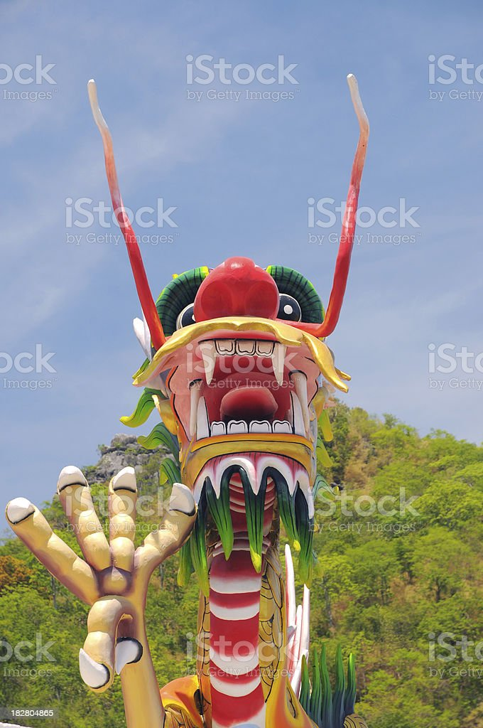 Big Chinese Dragon in front of mountain stock photo