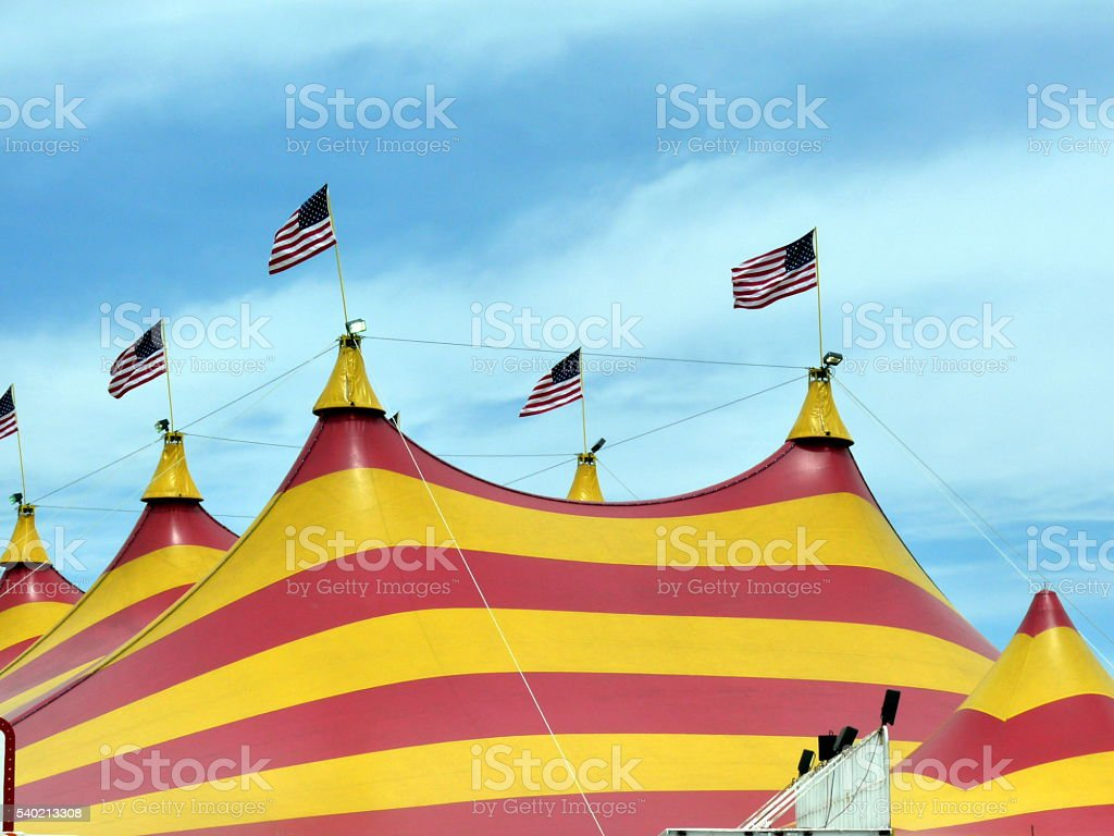 Big Circus Tent Top Blue Sky Flags Yellow Red Stripes stock photo