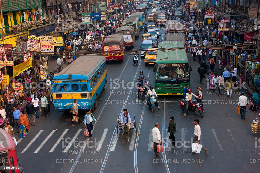 Big city street with thousands of people and the buses stock photo