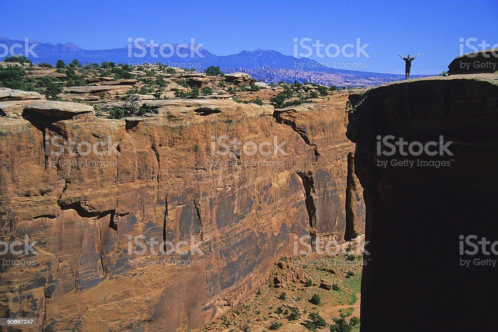 big cliff, little man! stock photo