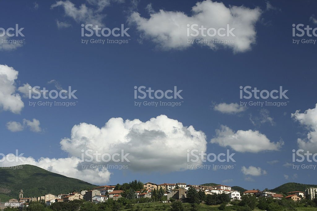 Big Clouds over Italian Mountain Village royalty-free stock photo