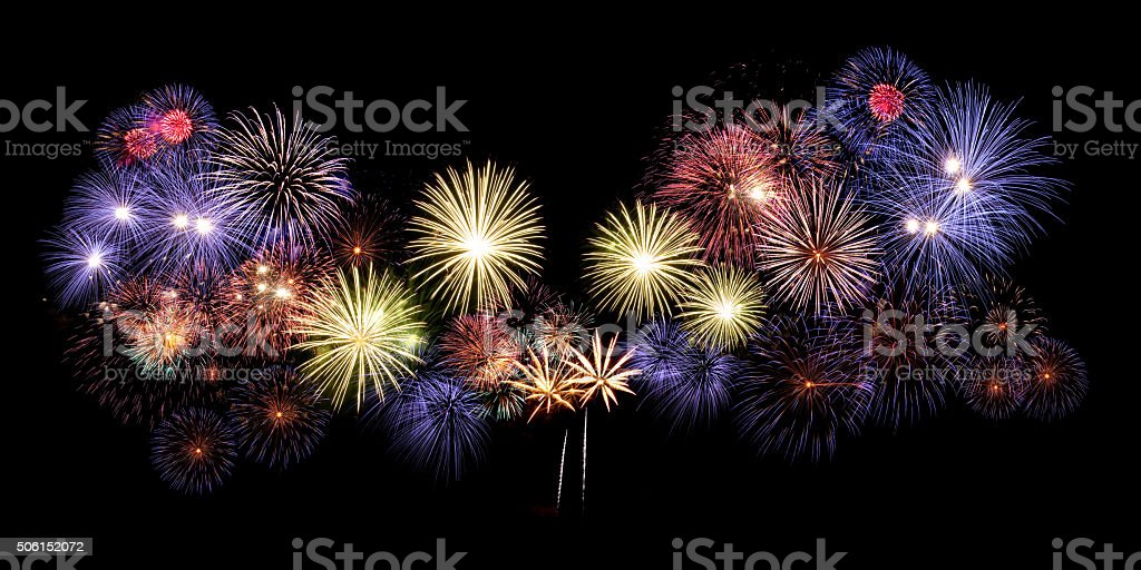 big colorful fireworks exploding in the sky stock photo