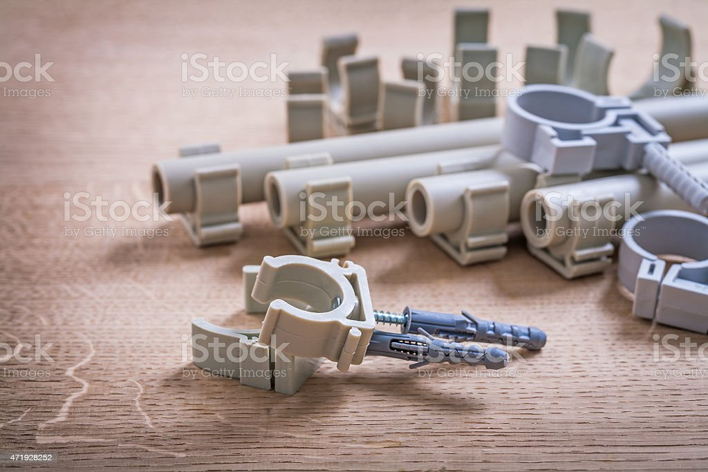 Big Composition Polypropylene Fixators And  Pipe  With Clips On stock photo