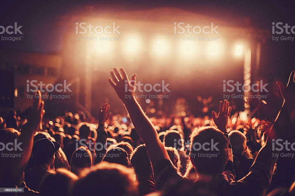 Big concert audience listening to music at festival