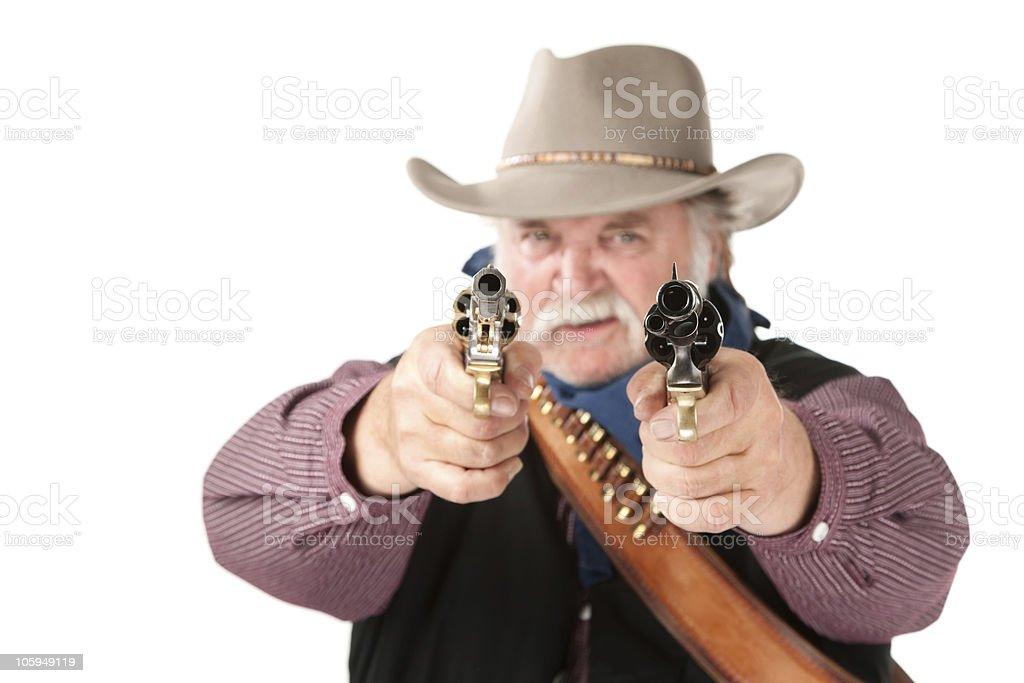 Big cowboy pointing pistols royalty-free stock photo