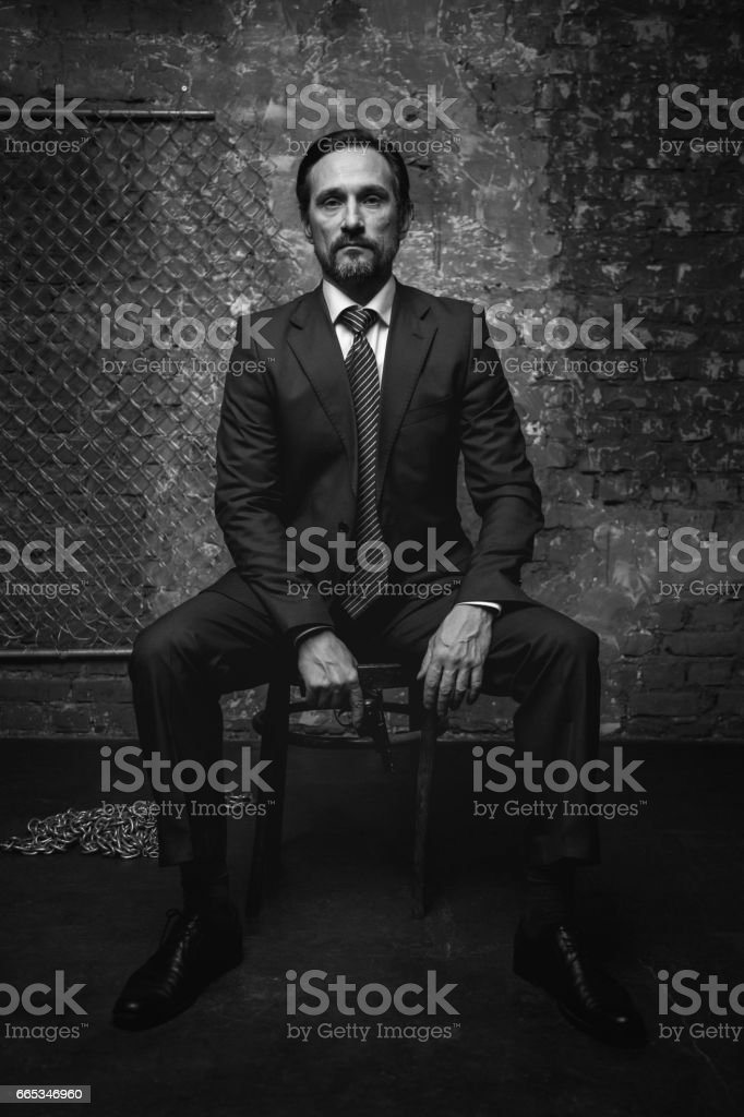 Big criminal boss having a conversation stock photo
