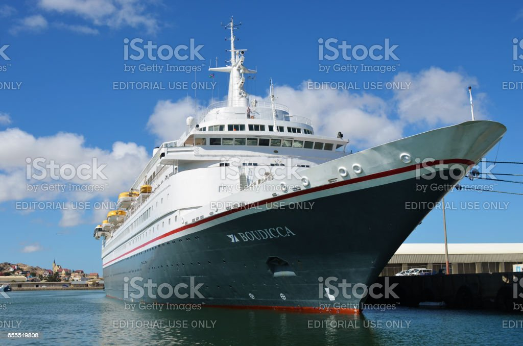 Big cruise ship Boudicca in the port of Luderitz in the early morning stock photo