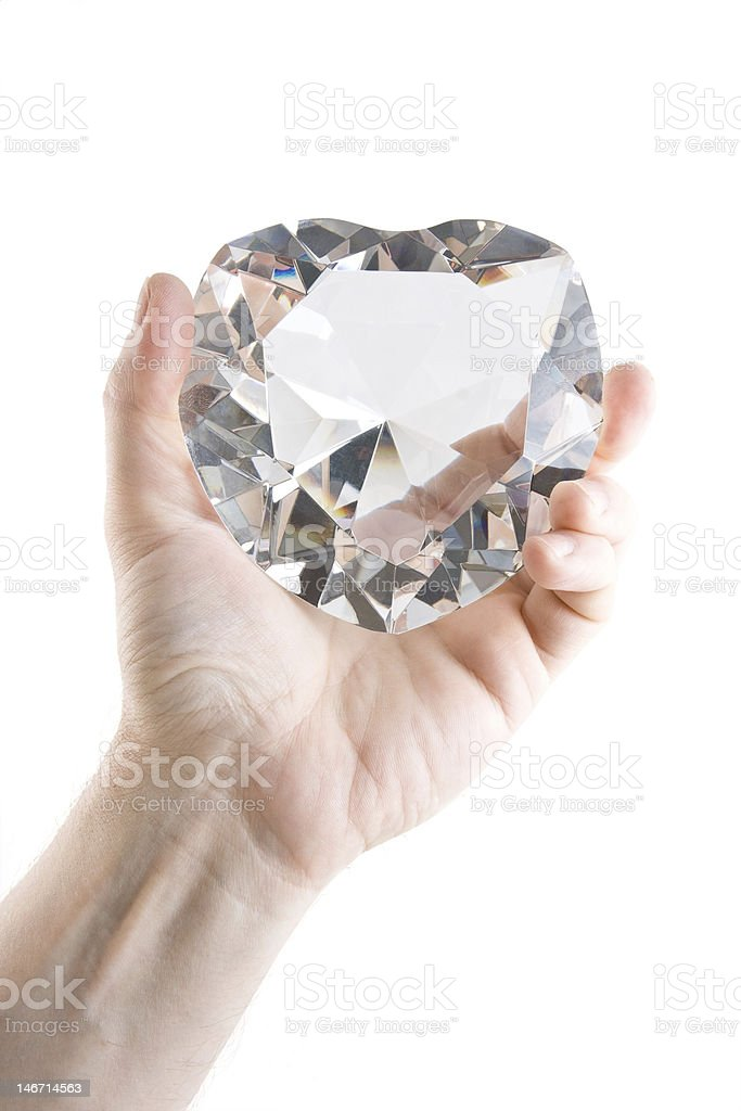 Big crystal heart in men's hand stock photo