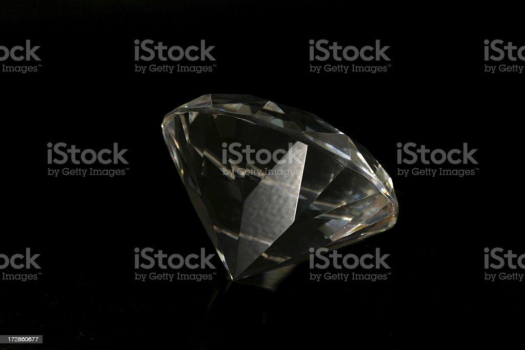 Big diamond on black stock photo
