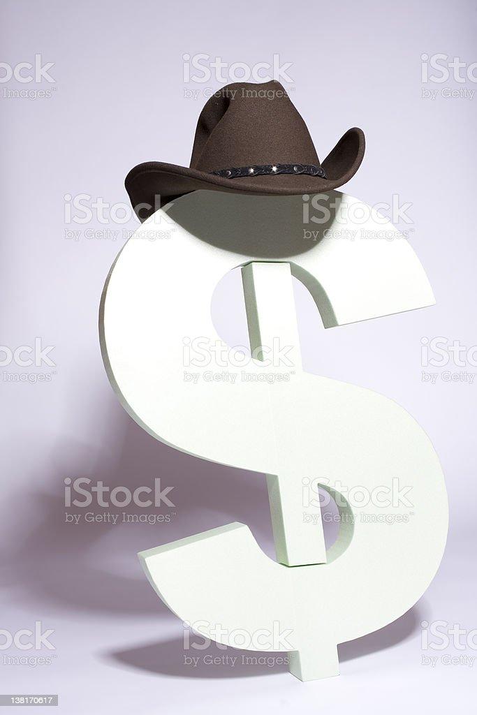 Big dollar sign and cowboy hat royalty-free stock photo